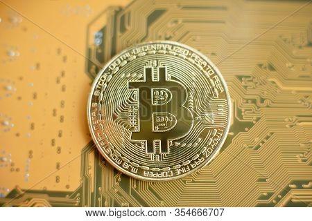 Bitcoin And Motherboard. Crypto Currency Gold Bitcoin, Btc, Bit Coin. Macro Shot Of Bitcoin Blockcha