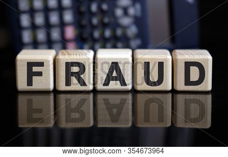 Fraud - Text On Wooden Cubes. Fighting Criminals And Scammers, Financial Pyramids And Corruption