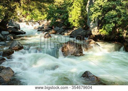 Sunny, Smooth Flowing Tenaya Creek In The Forest Near Mirror Lake. Yosemite National Park, Californi