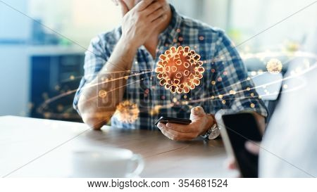 Terrified man is showing hologram of a virus model that floating over smartphone display to his friend. Using augmented reality technology at public space.