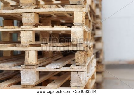 Pallets. A Range Of Wooden Pallets. Inventory For Shipment In The Warehouse.
