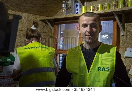 Belgrade, Serbia - April 2, 2016: Volunteer From Ngo Refugee Aid Serbia Standing In A Facility Prepa