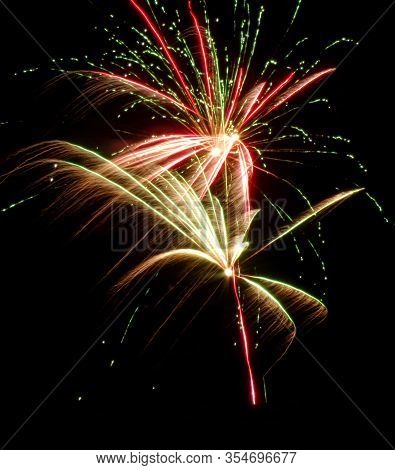 Fireworks Exploding In The Night Sky. Public Holiday. Vertical Image. Celebrate Holidays. Festive Fi