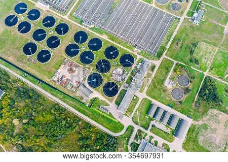 Sewage Treatment Plant With Clarifier Sedimentation Tanks At Suburban Industrial Zone. Aerial Top Vi