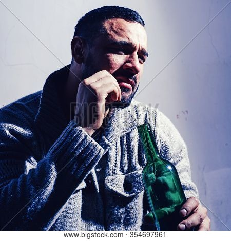 Alcohol Addicted Man. Bachelor And Single. Lonely Man Drink Wine From Bottle. Sad Depressed Male Adu