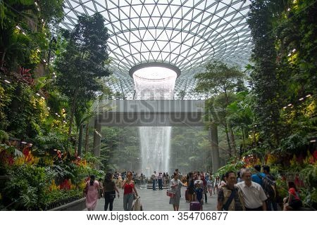 Singapore, January 25, 2019: The Rain Vortex, A 40m-tall Indoor Waterfall For Tourist Located Inside