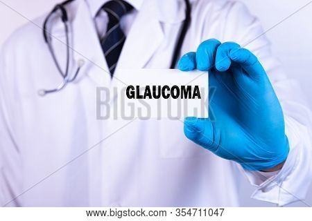 Doctor Holding A Card With Text Glaucoma Medical Concept