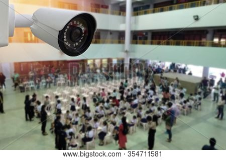 Cctv Camera Monitoring People In Hall Area.