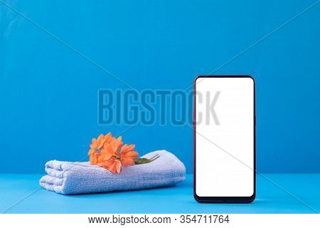 Blank Screen On Mockup Smartphone On Blue Background, Concept Of Relax Time.