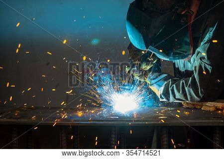 Welder Performs Welding Work Semi-automatic Electric Arc Welding. Mig Welding.