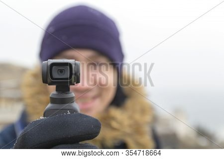 A Man Travels And Takes Off Everything Seen On The Action Camera .focus On Action Camera.winter.