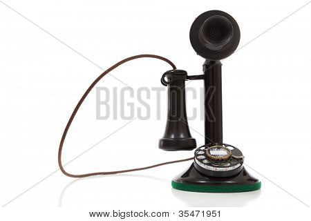 antique, vintage candlestick telephone on a white background