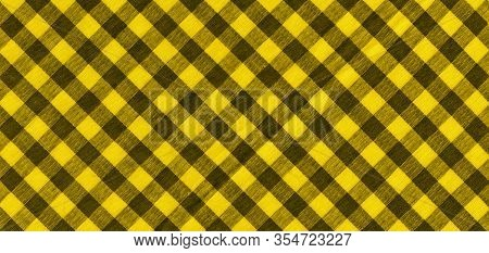 The Texture Of The Bright Yellow Of Binding Gingham Fabric. Yellow Textile Background. Fabric Plaid.