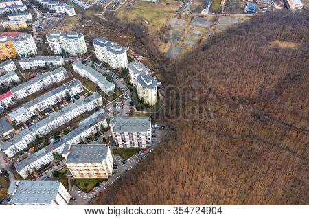 Above Aerial View Of Urban Environment, City Taking Place Of Nature. Expanding Flat Of Blocks Occupy