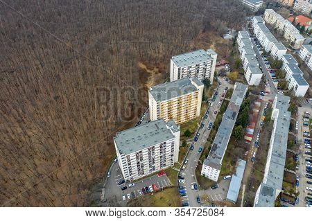 Aerial View Of Urban Environment, City Expansion Against Nature. Expanding Flat Of Blocks Occupy Vir