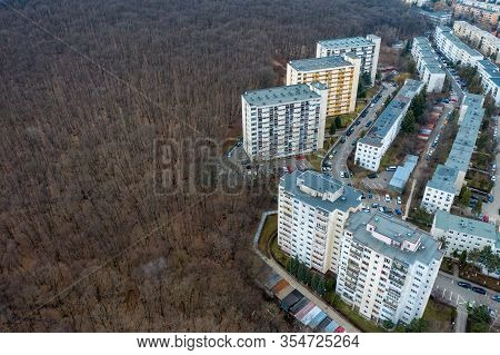 Aerial View Of Urban Environment, City Expansion Against Nature. Expanding Flat Of Blocks From The C