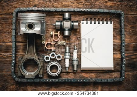 Car Fix List Template. Car Spare Parts And Blank Page Notepad On Brown Wooden Flat Lay Table Backgro