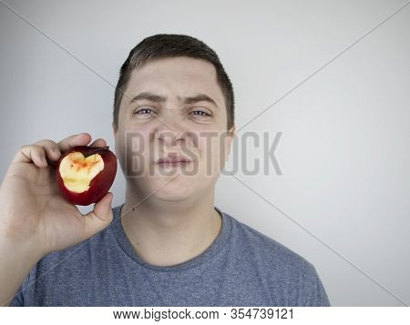 A Man Bit An Apple And Blood Came Out Of His Gums. Gum Bleeding, Symptoms Of Gingivitis, Periodontit