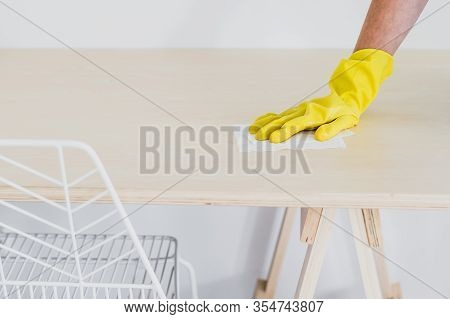 Disinfecting Surfaces From Bacteria Or Viruses Sill-life, Hand With Glove Cleaning Table With Disinf