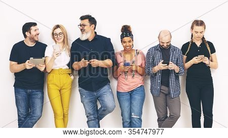 Multicultural Group Of Friends Addicted To Mobile Smart Phones - Diversity Concept And Friendship Wi