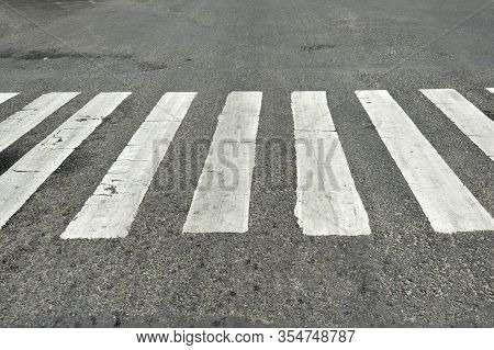 White Zebra Cross On The Grey Asphlat