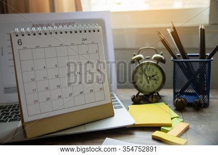 Planner And Calendar Concept.vintage Clock Vintage Clock Note Pad Placed On Office Desk.calendar For
