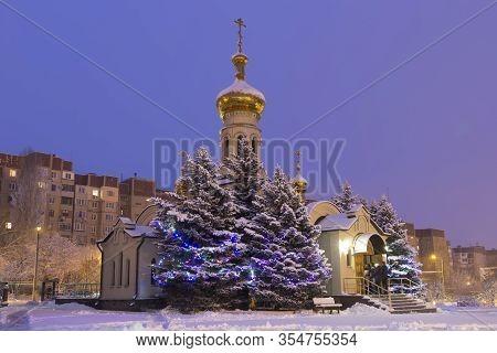 Donetsk, Ukraine. January 7, 2020.church Of St. Blessed Xenia Of Petersburg.snowy Winter, Predawn Ti