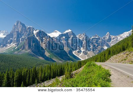 Nice mountain road over fantastic rocky mountains, Banff National Park, Alberta, Canada.