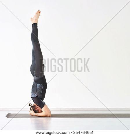 Man Yoga Class. Grey Sport Wear. Sirsasana Calm Relax Pose. Health Asana. Straight Vertical Male Per