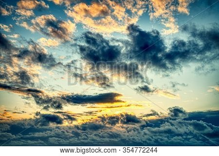 Dramatic Dark Orange, Black, Yellow And Red Sunrise Sky After Raining Natural Beautiful Sky For Back