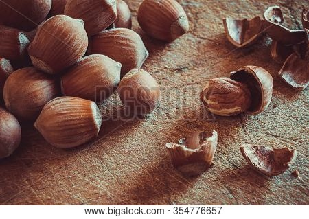Warm Hazelnut Hazelnuts On A Shabby Wooden Table