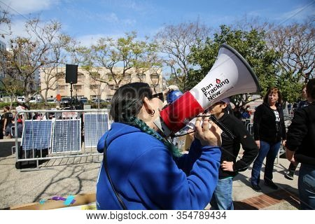 San Pedro, California / USA - March 6. 2020: Fire Drill Friday Rally in San Pedro, California. Protesters wave Signs, Yell into Megaphones against Oil Drilling and Climate Change. Editorial Use Only.