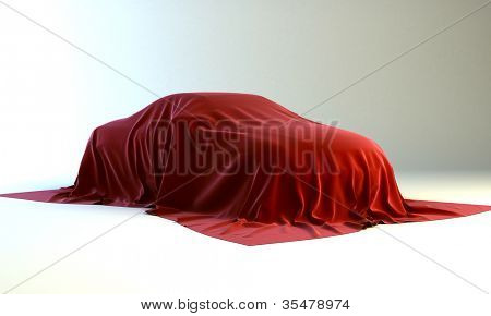 Presentation of the new car - automobile covered with a red cloth