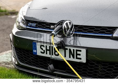 Glasgow, Scotland - July 31, 2019: The Volkswagen Golf Gte Plug-in Hybrid Car Charged At The Public