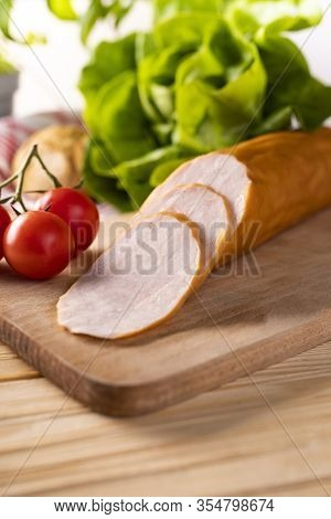 Poultry Krakowska Smoked Sausage. Chicken Cold Cuts. Poultry Cold Cuts On Wooden Cutting Board.