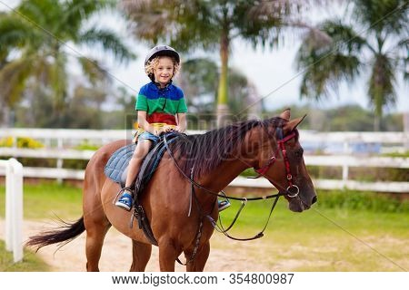 Kids Ride Horse. Child On Pony. Horseback Riding.
