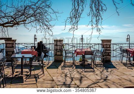 Makrinitsa / Greece - January 25 2020: An Unidentified Young Couple Enjoys The View From The Square.