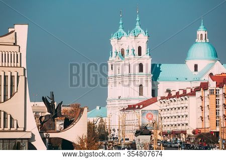 Grodno, Belarus - October 16, 2019: Grodno Regional Drama Theatre And St. Francis Xavier Cathedral I