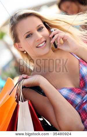 Woman making all during city shopping trip
