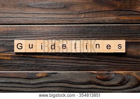 Guidelines Word Written On Wood Block. Guidelines Text On Table, Concept