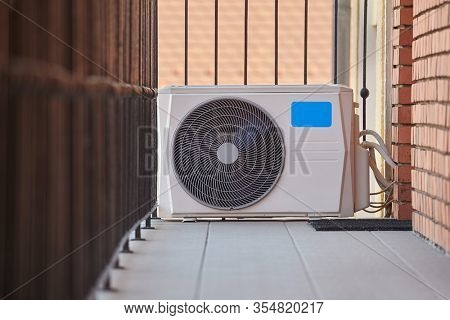 Exterior unit of an air conditioner outside an apartment