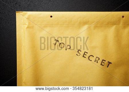 Top secret sentence on a brown envelope.