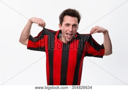 Excited Soccer Player In A Red Sportswear Isolated Over White Background. Sportswear For Soccer