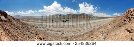 Pamir Highway Or Pamirskij Trakt. Panoramic View With Cyclist. Landscape Around Pamir Highway M41 In