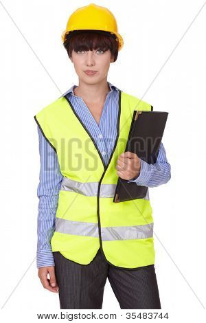Attractive female in yellow hardhat isolated on white