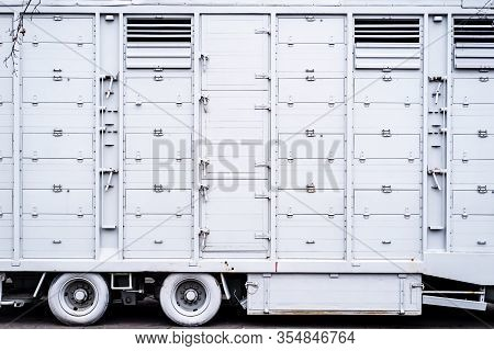 Unused Truck Trailer, Painted White, Standing On A Street In The City.