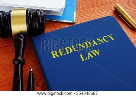 Redundancy Law Blue Book With Wooden Gavel.