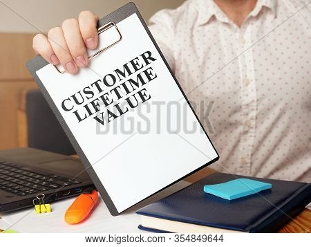 Man Is Holding Customer Lifetime Value Report.