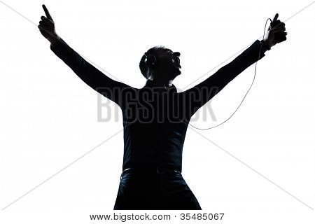 one caucasian man happy listening to music portrait silhouette in studio isolated white background