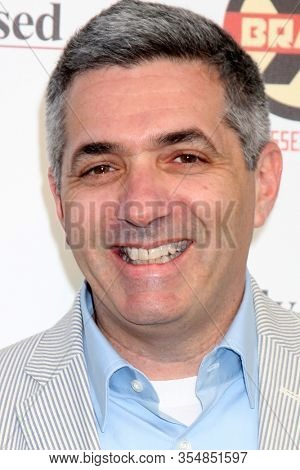 LOS ANGELES - JUN 12:  Chuck Sklar at the FX Summer Comedies Party at the Lure on June 12, 2012 in Los Angeles, CA